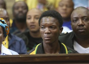 Victor Rethabile Mlotshwa, who was allegedly forced into a coffin, sits inside the Magistrates Court in Middelburg, South Africa, Wednesday, Nov. 16, 2016. AP